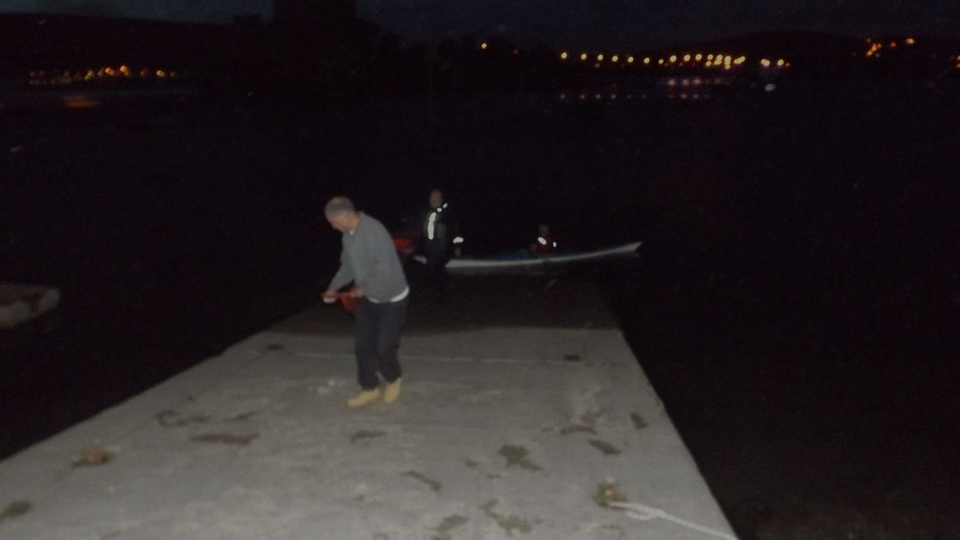 Dusk Dark Kev Skuse helping on slipway 30 percent